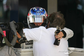 Race winner Kimi Raikkonen celebrates with Norbert Haug