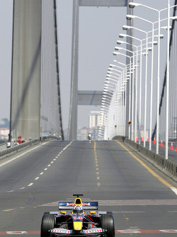 David Coulthard drives the Red Bull Racing car across the Bosphorus Bridge