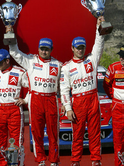 Podium: winners Sébastien Loeb and Daniel Elena celebrate victory