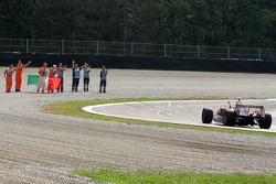Jarno Trulli waves to marshals