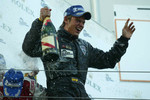 Podium: champagne for Tom Chilton