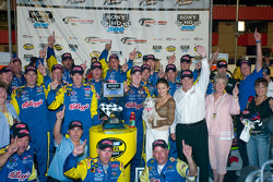 Kyle Busch celebrates his first NASCAR Cup win with his team