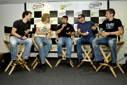 Scott Riggs and members of rock band Nickelback Daniel Adair, Chad Kroeger, Mike Kroeger and Ryan Peake speak to the media during a press conference