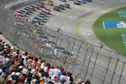 Talladega fans watch Elliott Sadler and Dale Jarrett as they lead the field to the green flag