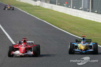 Michael Schumacher and Fernando Alonso battle