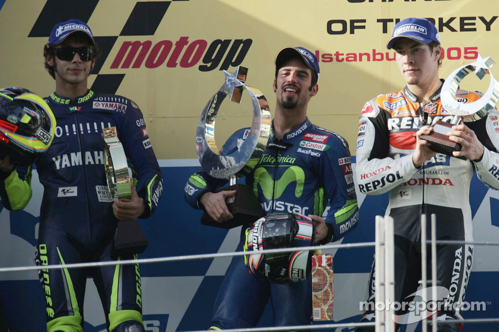 Podium: race winner Marco Melandri with Valentino Rossi and Nicky Hayden