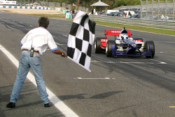 Alexandre Premat takes the checkered flag
