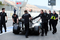 The Mercedes AMG F1 W06 of Lewis Hamilton, Mercedes AMG F1 is pushed back down the pit lane by mechanics