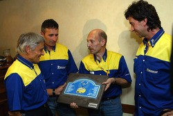 Pierre Duspasquier accepts a present for his retirement