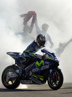Race winner Marco Melandri celebrates a little bit too much
