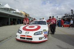 Target Dodge crew members push the #41 car