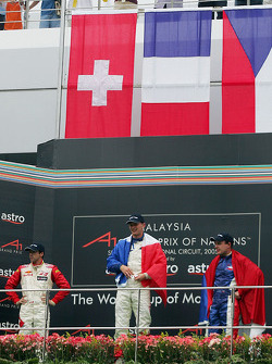 Podium: race winner Alexandre Premat with Neel Jani and Tomas Enge
