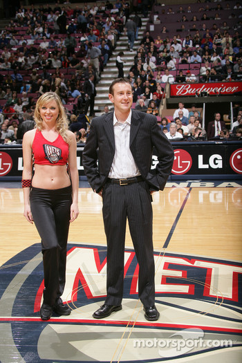 Kurt Busch and a New Jersey Nets dancer at the game between the New Jersey Nets and the Detroit Pistons at the Continental Airlines Arena in East Rutherford, New Jersey