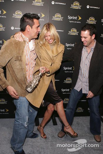 AJ Discala lifts Jimmie Johnson's wife at the 2005 NASCAR Nextel Cup Series Championship Party At Marquee