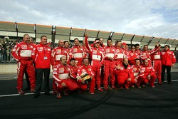 Luca Badoer poses with Ferrari team members