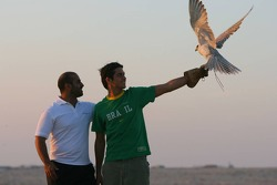 Nelson A. Piquet and Sheikh Maktoum Hasher Maktoum Al Maktoum with a falcon