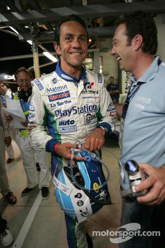 Pole winner Erik Comas celebrates