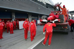 The Ferrari of Michael Schumacher back in the pits after having stopped on the track