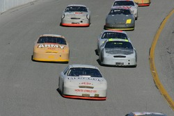 Paul Menard leads a group of cars