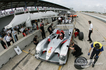 Rinaldo Capello sits the new Audi R10 while crew members work on the car