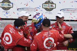 Scott Dixon celebrates with teammates