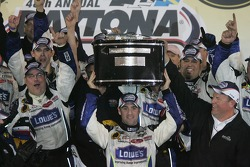 Victory lane: Jimmie Johnson hoists winners' trophy