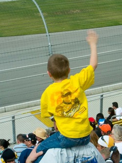 A young fan of Matt Kenseth cheers