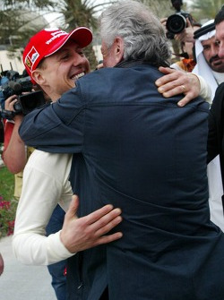 Pole winner Michael Schumacher celebrates with Willi Weber