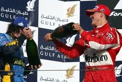 Podium: champagne for Fernando Alonso and Michael Schumacher