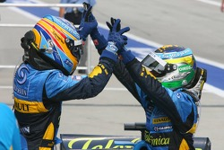 Race winner Giancarlo Fisichella celebrates with Fernando Alonso