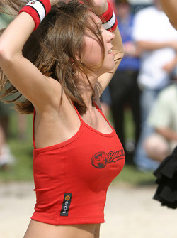 Beach volley match: a lovely Bacardi girl stretches