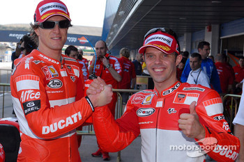 Pole winner Loris Capirossi celebrates with second qualifier Sete Gibernau