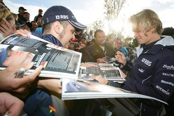Nico Rosberg signs autographs