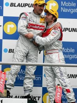 Podium: Heinz-Harald Frentzen congratulates race winner Bernd Schneider