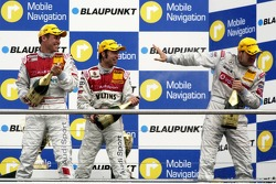 Podium: Bernd Schneider receives a champagne shower