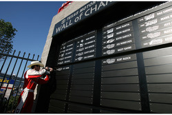 Kasey Kahne drills his name plate into the 'Wall of Champions' after winning the race