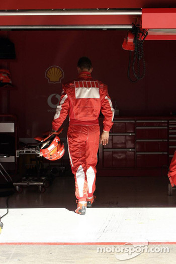 Michael Schumacher back to the pits after stopping on the track