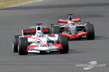 Takuma Sato and Kimi Raikkonen