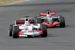 Takuma Sato and Kimi Raikkonen