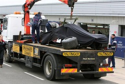 The Red Bull Racing car of Vitantonio Liuzzi, test driver, is returned to the pits after a crash