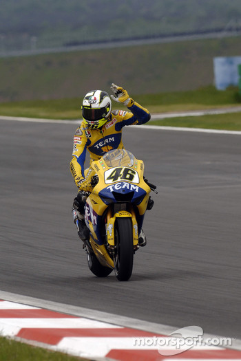 Valentino Rossi waves to the fans