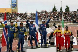 Podium: winners Sébastien Loeb and Daniel Elena, with second place Petter Solberg and Phil Mills, and third place Gianluigi Galli and Giovanni Bernacchini