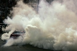 Dale Earnhardt Jr. does a burnout in celebration