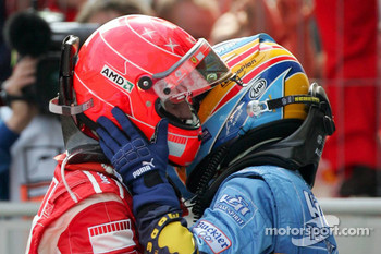Race winner Michael Schumacher celebrates with Fernando Alonso