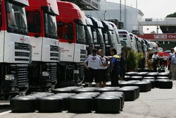 Honda F1 Racing team members prepare their Michelin tires