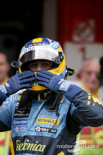 Pole winner Fernando Alonso celebrates