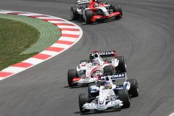 Jacques Villeneuve leads Takuma Sato
