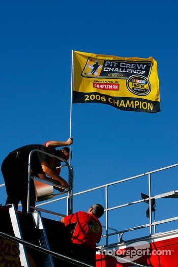 The pit crew of Martin Truex Jr. raise the flag after winning the 2006 Pit Crew Challenge