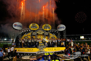 Jimmie Johnson and his crew celebrate after winning the NASCAR Nextel Cup Series All-Star Challenge