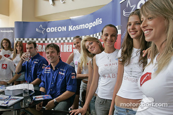 Sbastien Loeb and Daniel Elena with lovely girls